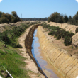 Leveed deep drain