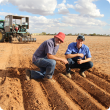DPIRD principal research officer Dr Ed Barrett-Lennard (left) and Southern Cross farmer and inventor, Callum Wesley, inspect wheel furrow and mound formation systems at Merredin to channel water towards plant roots to reduce the impact of transient salini