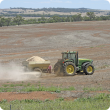 Surface application of agricultural lime using a tow-behind spreader