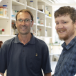 DPIRD Grains R&D Post Graduate Scholarship recipients Martin Harries and Andrew Phillips pictured in a laboratory