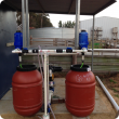 Fertiliser dosing system using two tanks