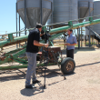 Videographer filming grower Cam Fraser on the Cams property in Quairading