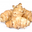 Light brown irregular shaped tubers of Jerusalem artichokes