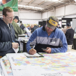The Department of Primary Industries and Regional Development team will be back at Dowerin Machinery Field Days with large property maps available for farmers to check out their properties. Pictured at a previous Dowerin Field Days event is DPIRD research