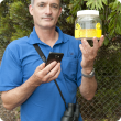 Department of Primary Industries and Regional Development senior technical officer Marc Widmer with a European wasp trap.