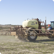 Boom sprayers are pulled by a tractor to spray large areas of land