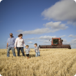 A family standing in a field of wheat