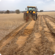 One-way disc plough in action