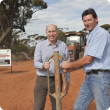 Agriculture and Food Minister Ken Baston and Department of Agriculture and Food State Barrier Fence Project Manager Craig Robins at the site of construction to close the Yilgarn Gap.