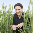 Svetlana Micic with snails in wheat crop, Snapbait app