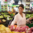 Asian woman shopping in a fresh food supermarket