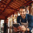 man-with-ipad-at-brewery