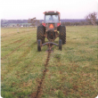 tractor pulling mole plough to dig a mole drain