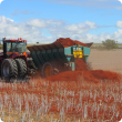 A multi-spreader applies clay to a sandy paddock near Moora as part of a DAFWA project to examine the production and economic benefits of claying.