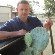 Biosecurity Officer James Sheehan with a segment of wheel cactus